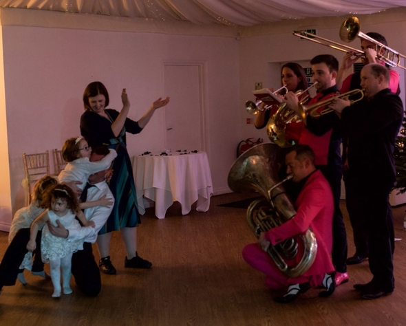 Oompah Brass playing at a wedding
