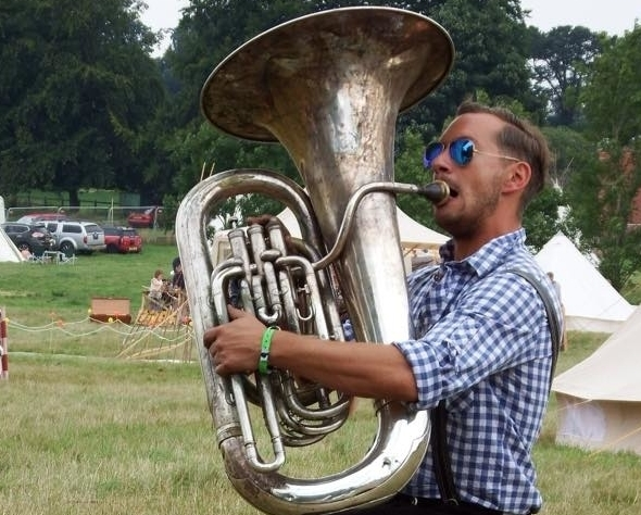 Tuba player in lederhosen at a festival